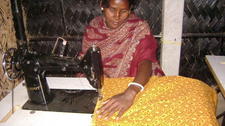 Indian women using a sewing machine