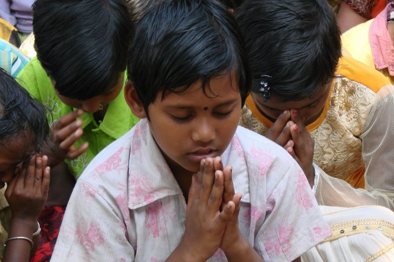 Vision for Asia boy praying